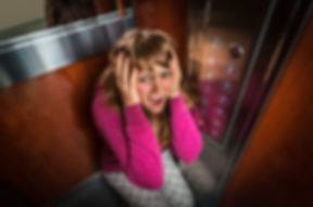 Shocked woman with claustrophobia in the