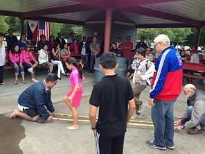 Tinikling Dance - hop in between two bamboo sticks and don't let your feet get caught.