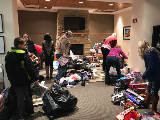Volunteers set up the gift room before children arrive for the party.