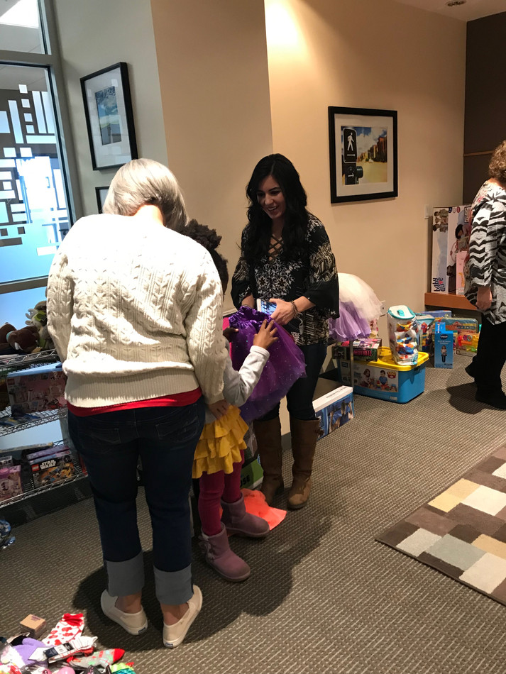 """Families enter the """"gift room"""" one at a time so kids can choose their gifts without pressure."""