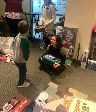 Natasha, a Max's Treehouse board member, helps a child decide his favorite two gifts.
