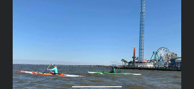 Kristin Helm and Tina Burgos paddle the Kemah Channel