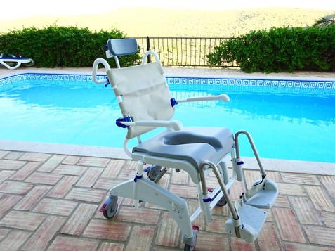 Tilting shower chair