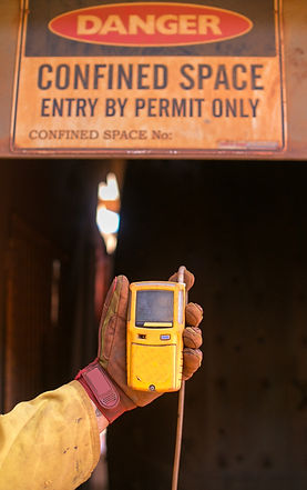 Constructor worker hand holding gas test