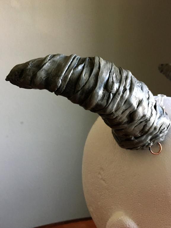 Puck's Horns Detail