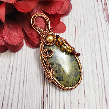 Tremendous Green Apidot Oval with Garnet and Topaz Briolette, and Glass Pearls