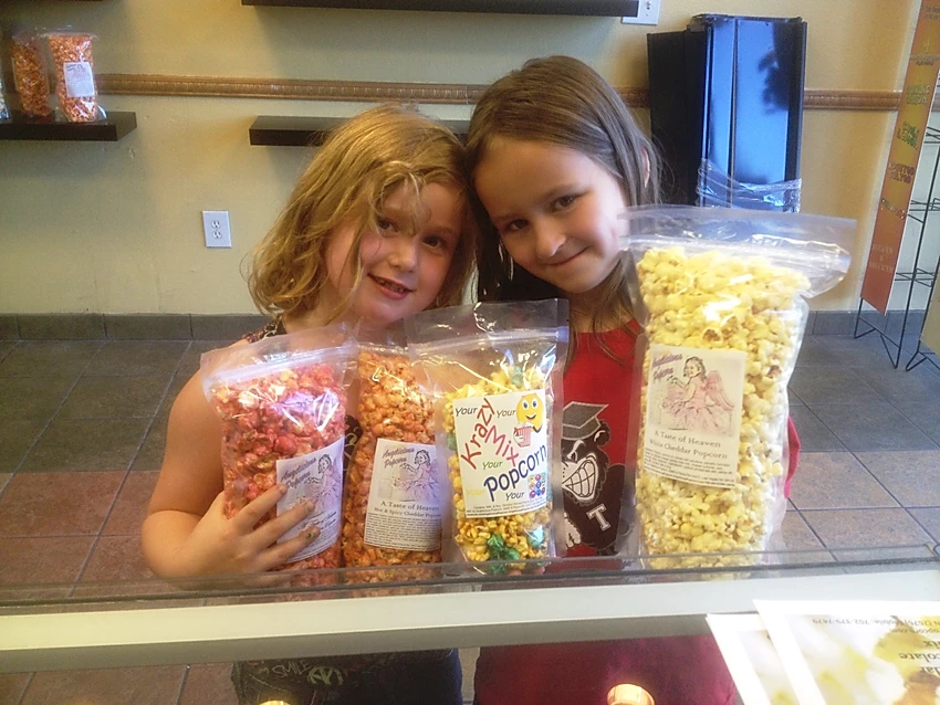 2 Little girls & popcorn