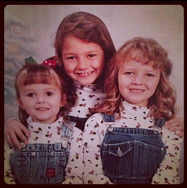 A young Kate and her sisters looking very 90s