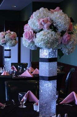 Elegant Flowers In Lit Vase