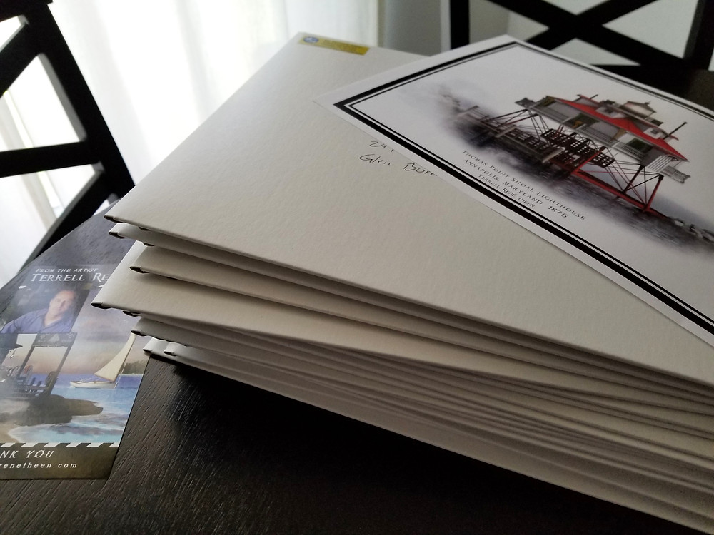 Image of the Thomas Point Shoal Lighthouse print by Terrell René Theen being sent for contributors to the fundraiser.