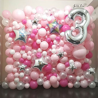 Balloon wall for a third birthday