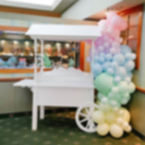 Candy cart and pastel balloons for a gen
