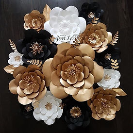 A set of black, white, and gold flowers