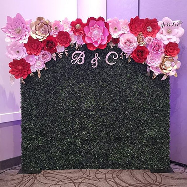 Boxwood wall with paper flowers