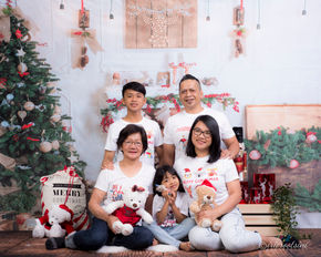 Family in White Christmas Theme
