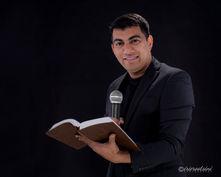 Pastor Headshot-Holding-Bible-Mic