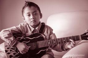 Kid-Playing-Guitar-1.jpg