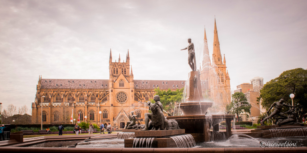 Archibald Fountain pointing at the St. Mary's Cathedral