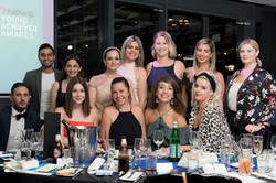 Corporate-Event-Photography-Sydney-Group-Photo-at-Table