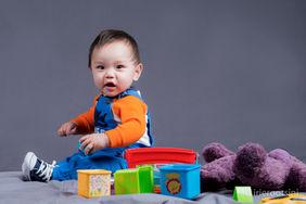 Baby-boy-smile-camera-studio-session-plu