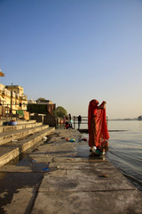 Indian woman washing her clothes in Udaipur