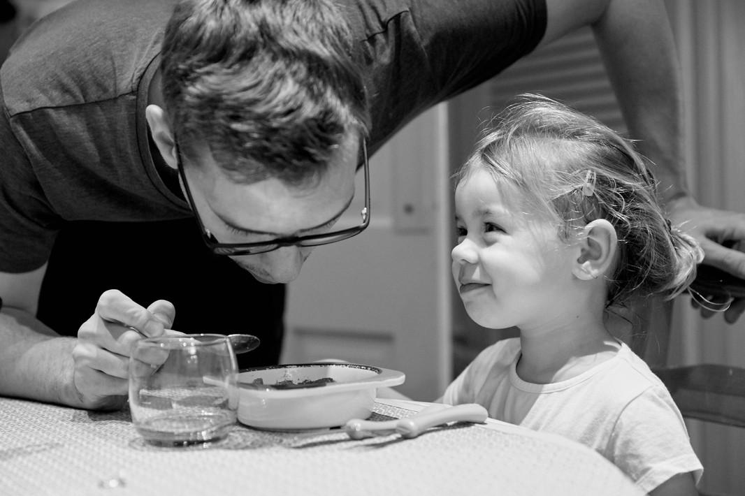 Girl adoringly looking at her Dad
