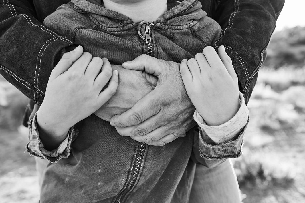 Dad & son embrace