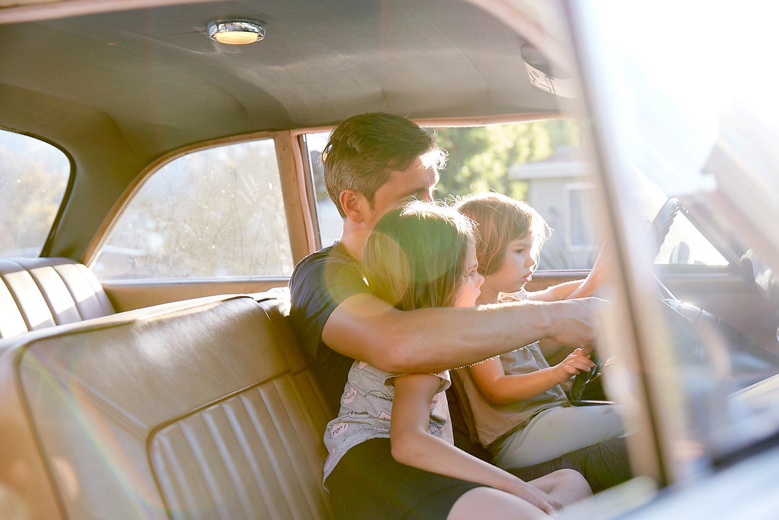 Dad & Daughters sharing memories in vintage car | photodefamilleLA | PHOTODEFAMILLELA | LA Family Photographer