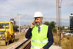 Engineer railway looking drawing on rail