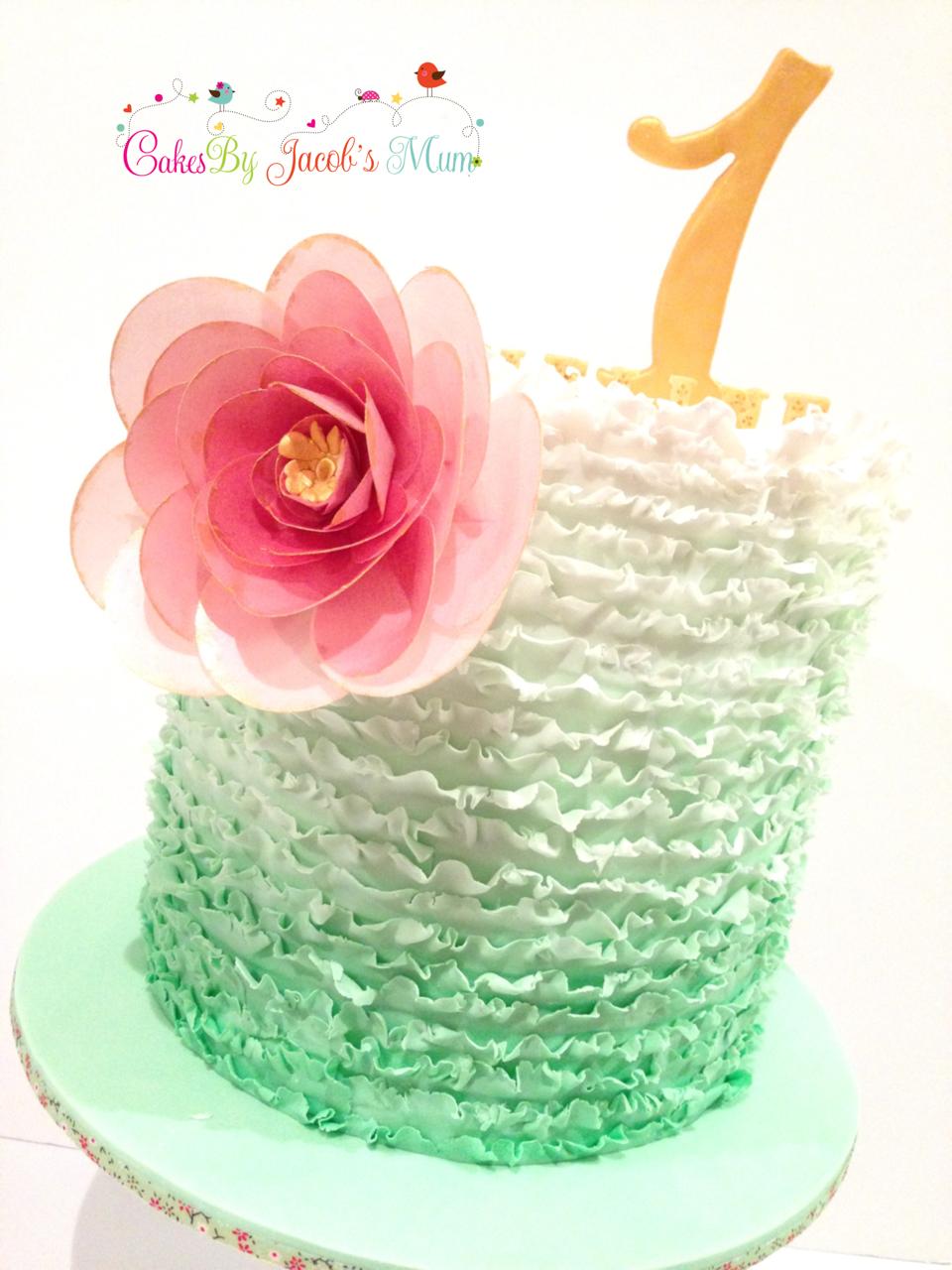 Ombre green ruffles cake pink flower