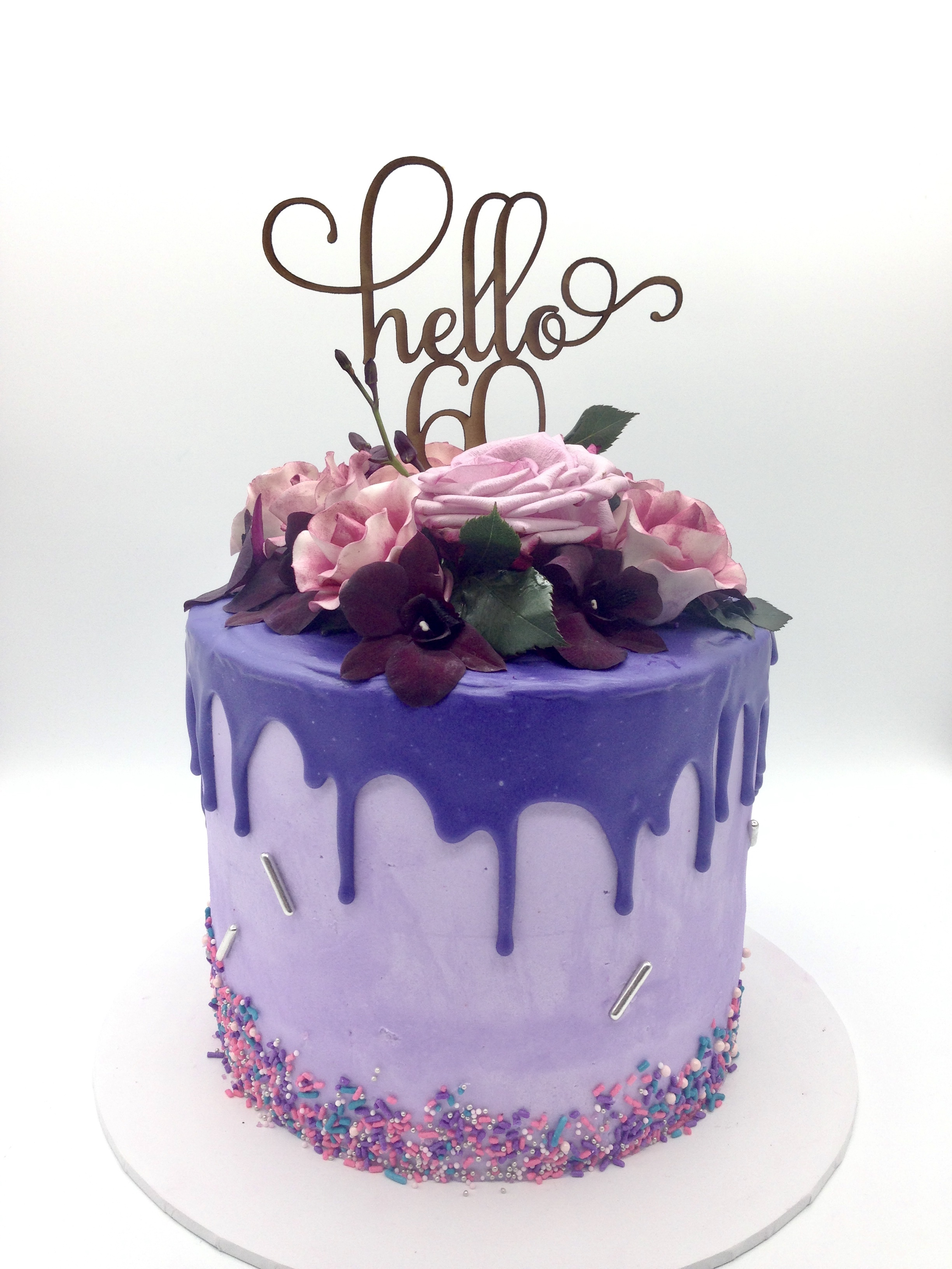 Purple flowers drip 60th cake