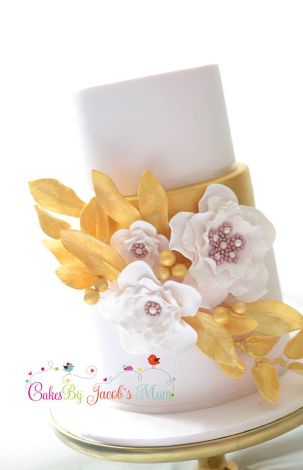 Gold and light pink wedding cake