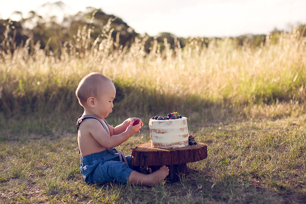 baby plaing with cake