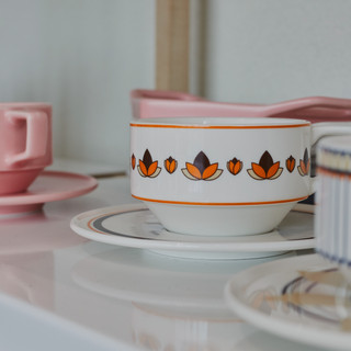 April in May Thanksgiving line a set of coffee cups and saucers.