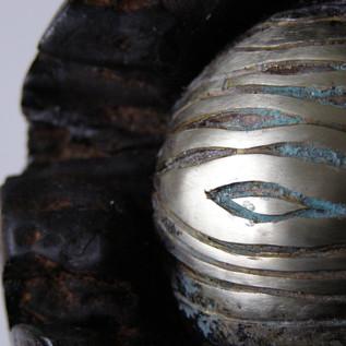 Carved wood grain metal