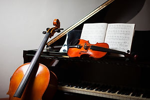Classical music concept_ cello, violin, piano and a score.jpg