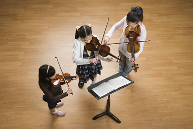 Asian girls playing violins.jpg
