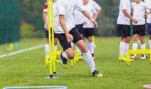 Boy Soccer Player In Training. Boy Runni