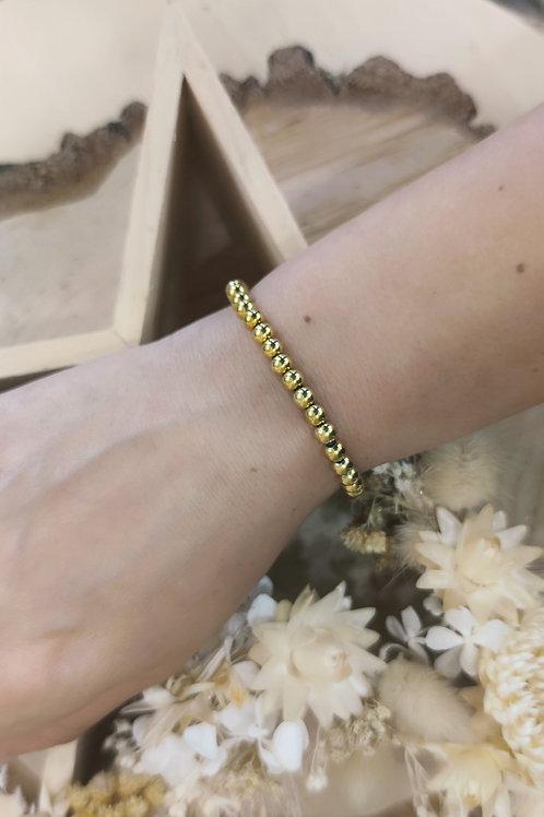 Bracelet en acier doré élastique