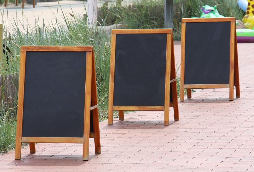 Empty advertising chalk boards