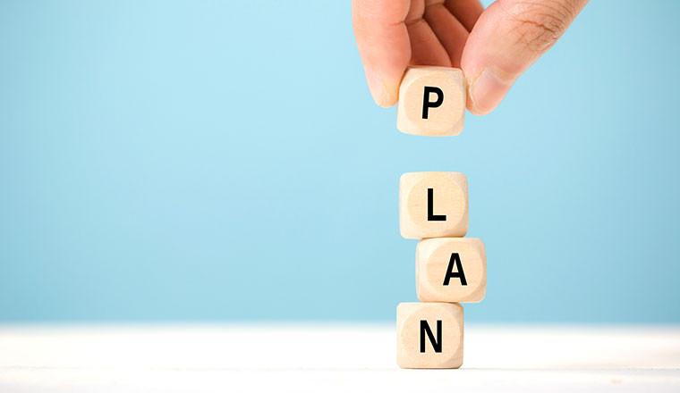 Plan written on dice