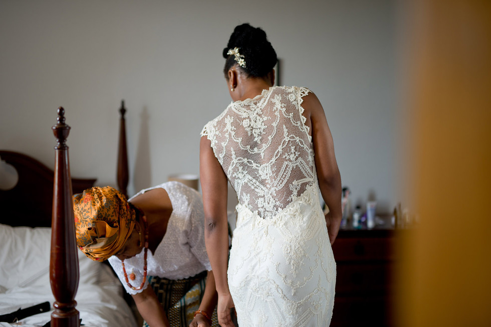029 Bride's mum helps with the dress.jpg