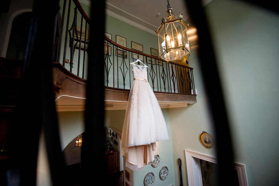 Wedding dress hanging at Homme House