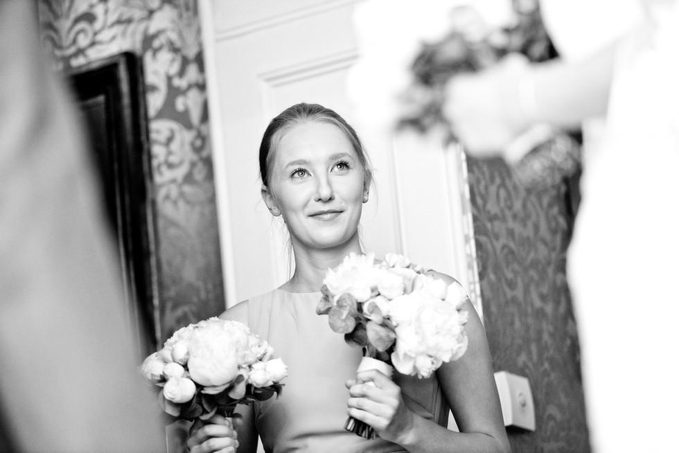 048 Bridesmaid holding bride's bouquet a