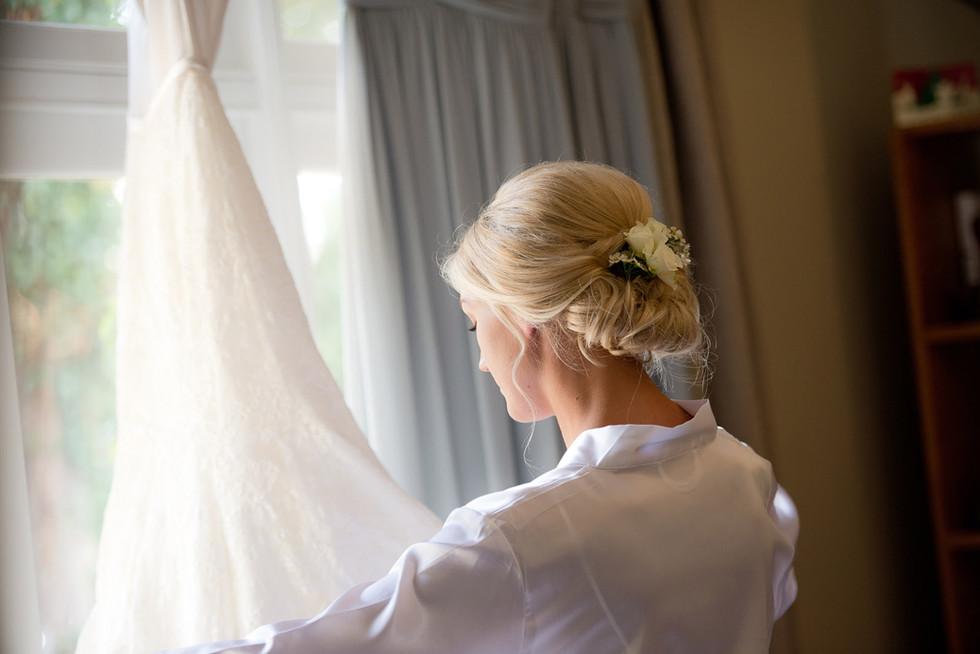 005 Bride admires her dress.jpg