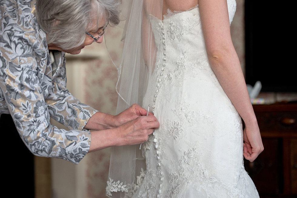 019 Bride's Mum buttoning her dress at B