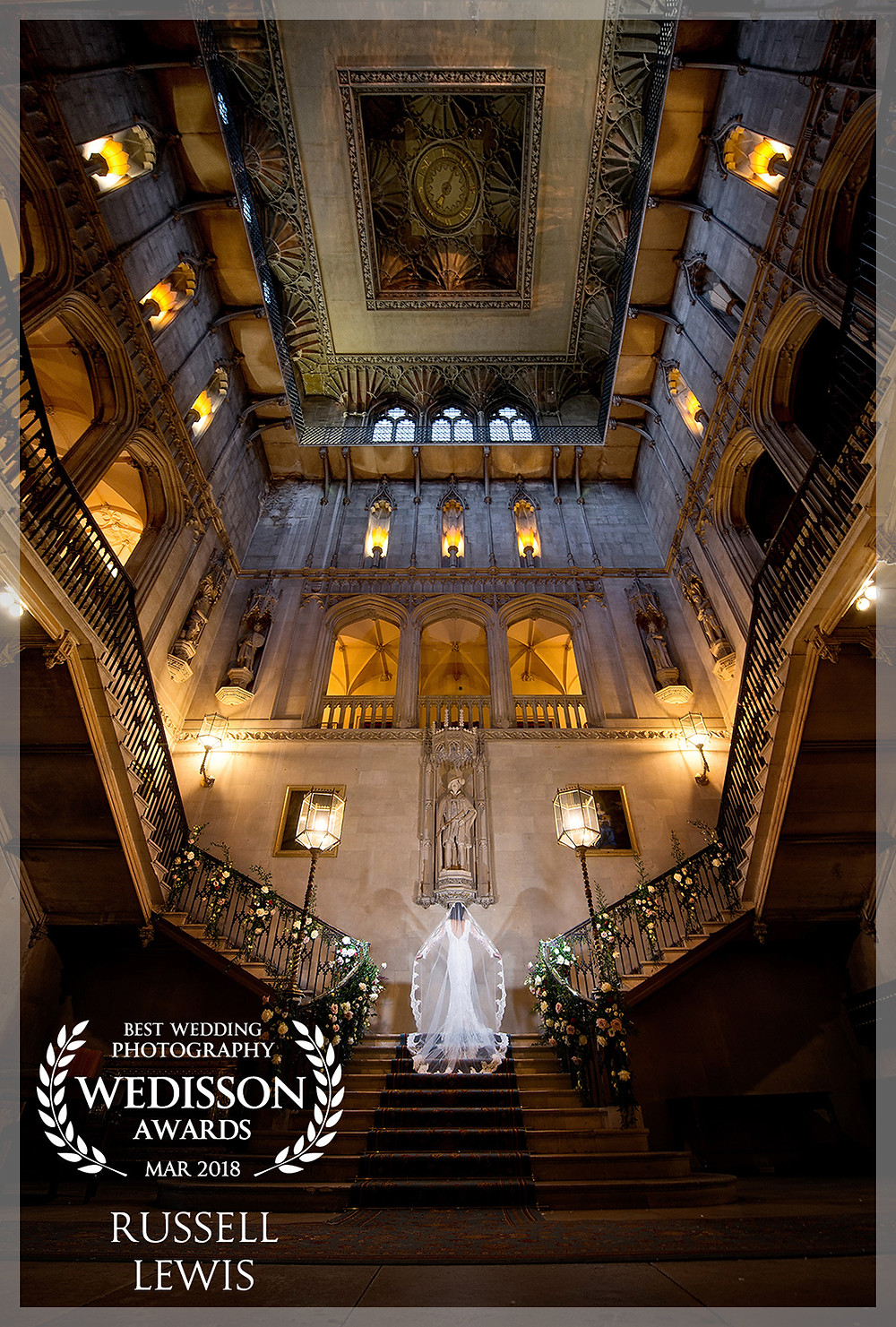 Bride on the stairs at Ashridge House