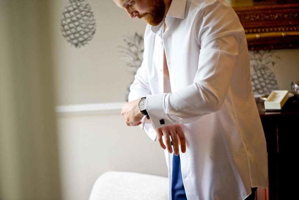 Groom with cufflinks at Lemore Manor