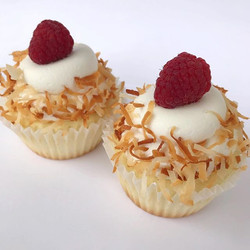 Coconut Raspberry Cupcakes❤️ vanilla cake, raspberry filling, coconut buttercream, rolled in toasted