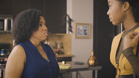 Caption: Jasmine Runnels and Tabitha Mitchell in JANUARY 14TH written and directed by La'Chris Jordan.